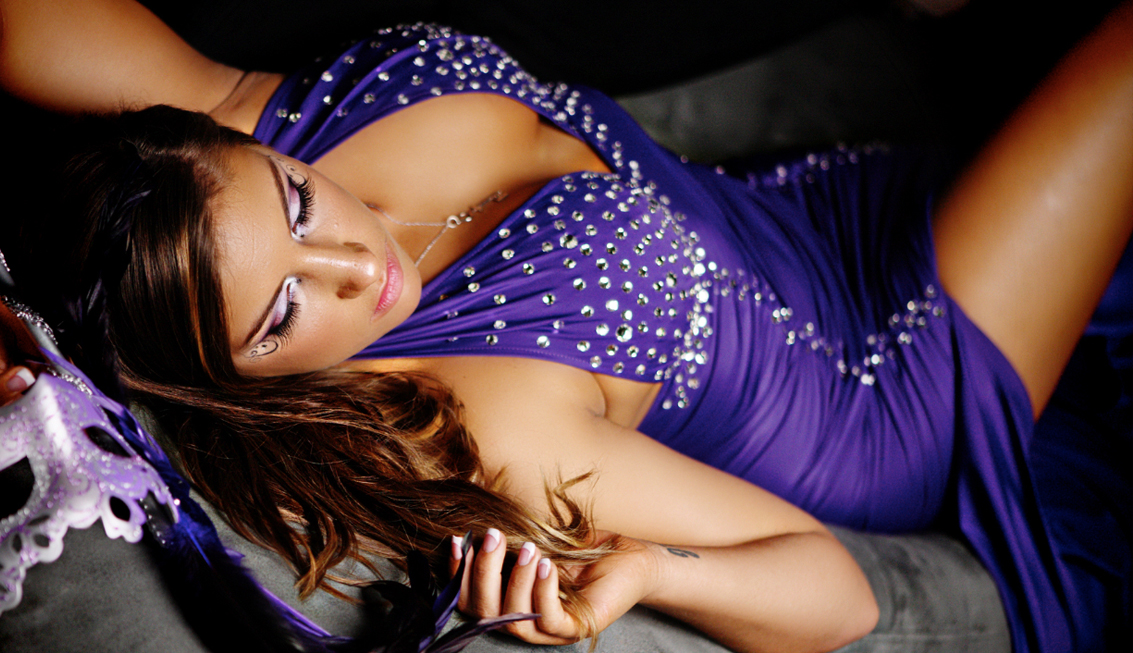 Closeup picture of Penthouse girl wearing purple dress