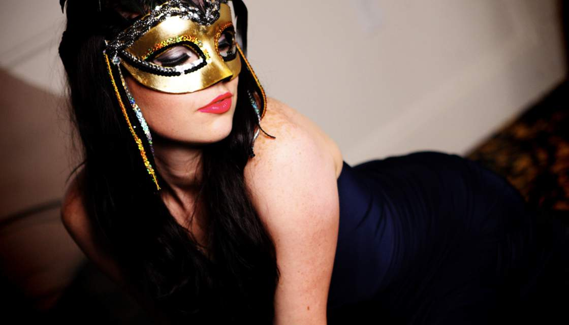 Girl wearing black and gold mask at Penthouse Anniversary Party photo