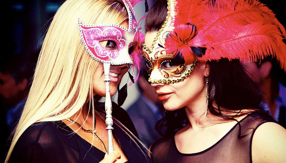 Two Penthouse girls in masks at a strip club party photo