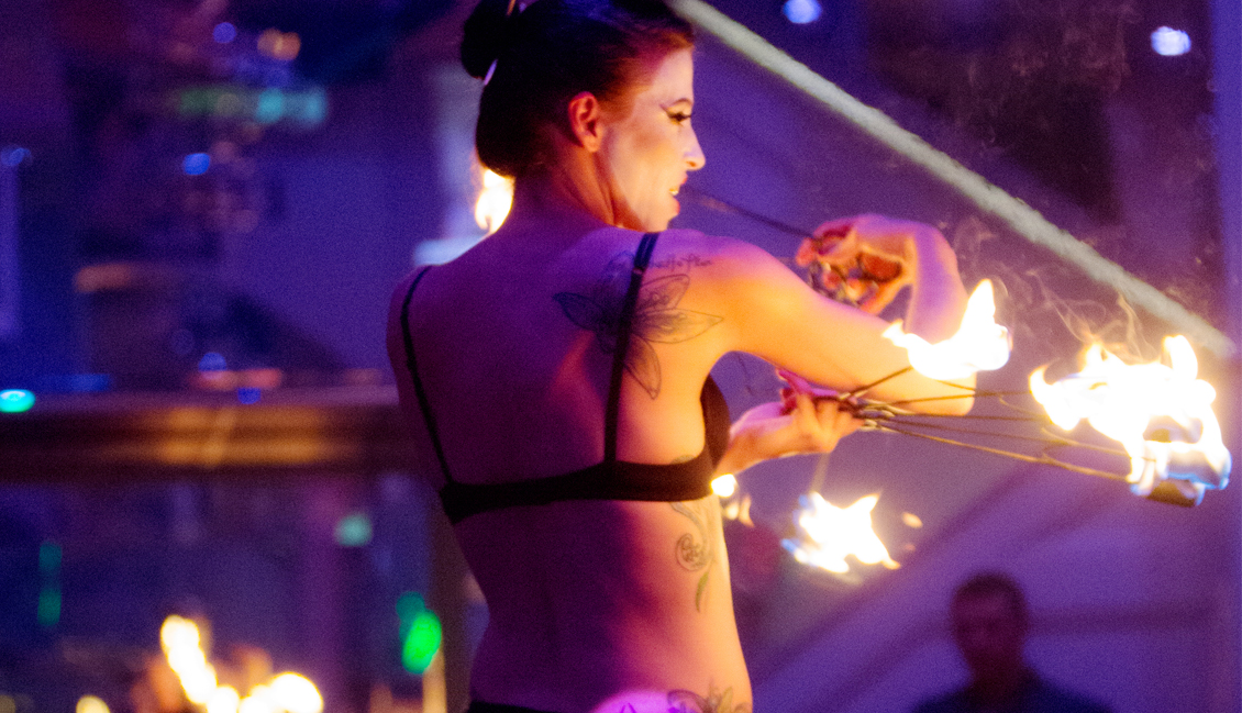 Baton Rouge Strip Clubs, Dancer With Fire Image - The Penthouse Club