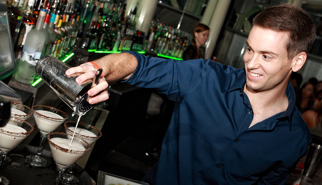 Smiling Bartender Pours Drink, Night Clubs, Baton Rouge, LA Image - The Penthouse Club