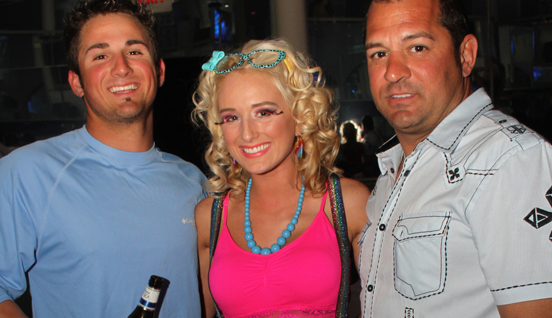 Pink party in a Baton Rouge strip club with two happy men image - The Penthouse Club