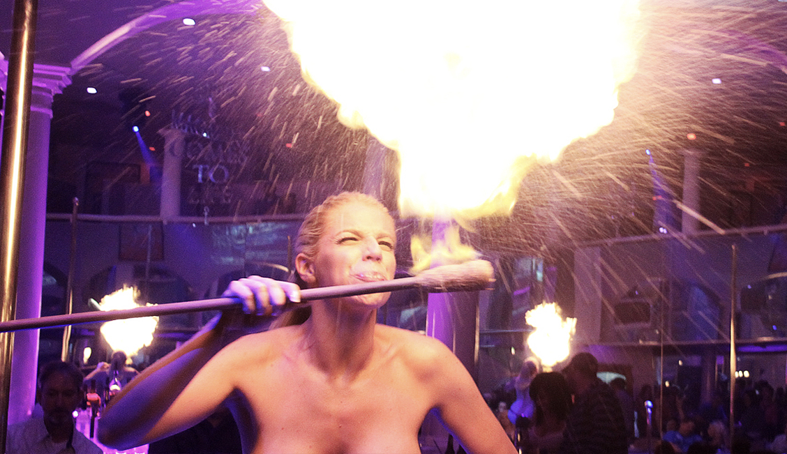 A topless fire breathing Penthouse naked stripper in Baton Rouge image - The Penthouse Club